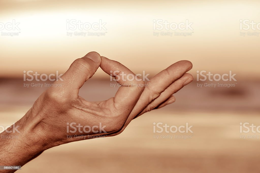 hand of a man in gyan mudra stock photo