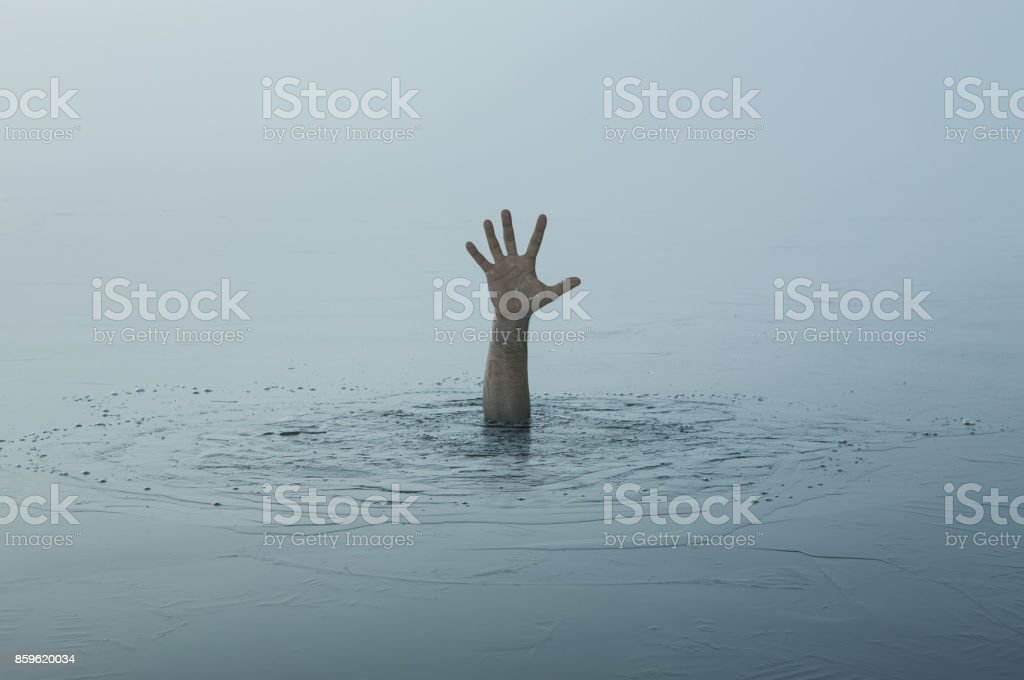 Hand of a sinking man