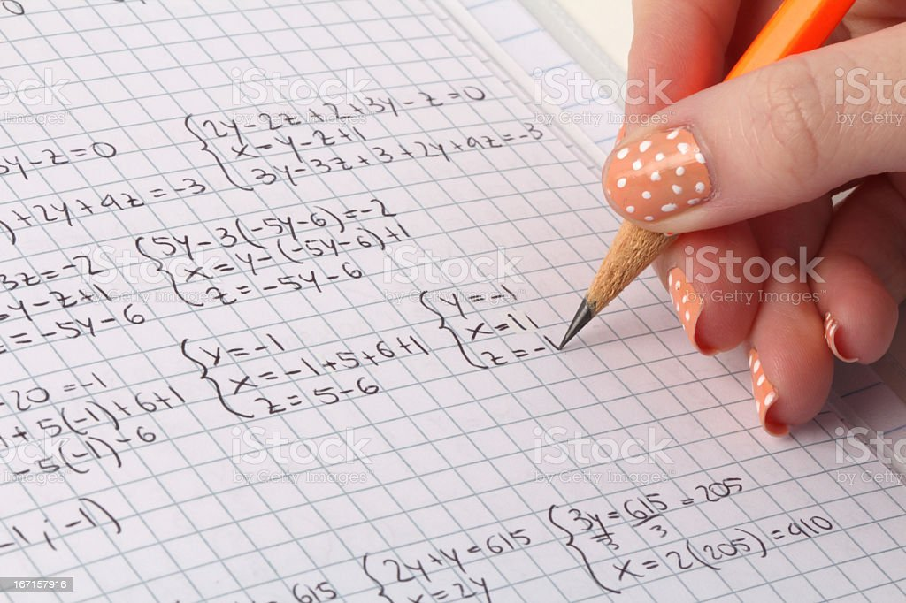Hand of a student doing math royalty-free stock photo