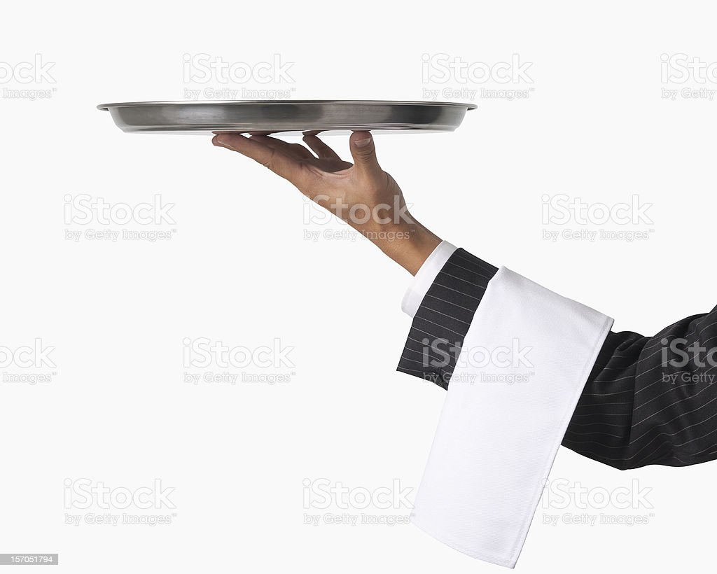 Hand of a waiter holding up an empty platter for service stock photo