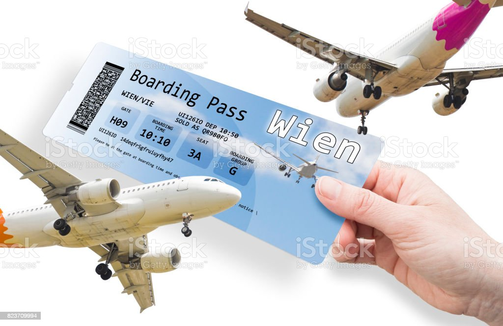 Hand of a woman holding a airplane ticket to Wien - image isolated on white.'nThe contents of the image are totally invented. 'nThe image background with the sky and the airplane are a picture of my property.