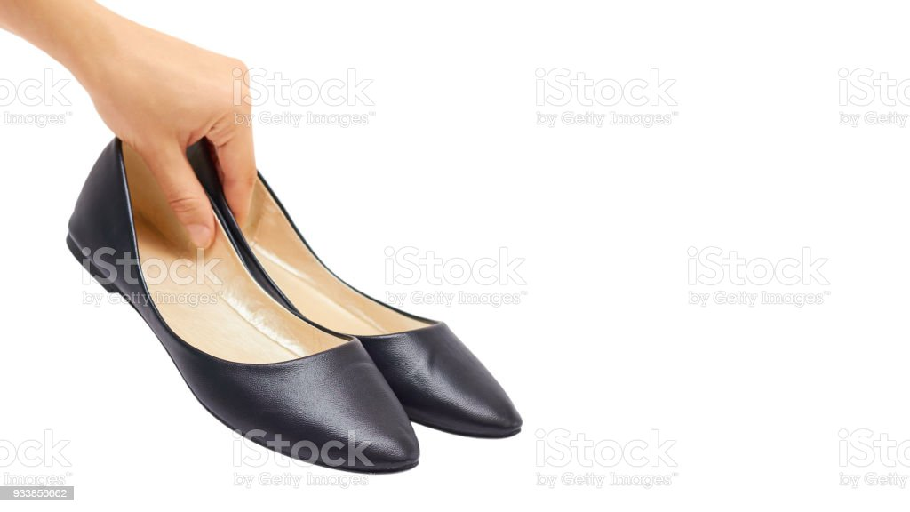 Hand of a woman holding shoes isolated on white background. copy space, template stock photo
