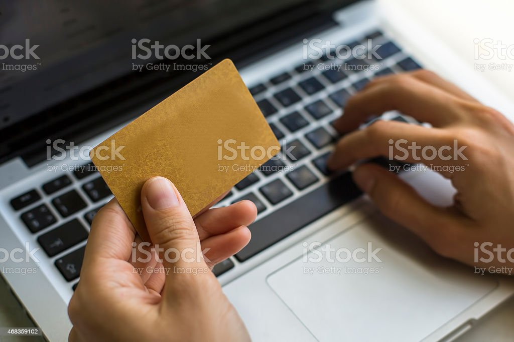 Hand of a woman making purchases through the Internet royalty-free stock photo