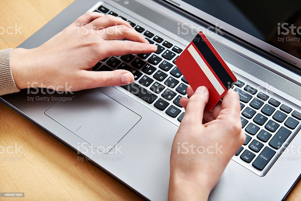 Hand of a woman with credit card stock photo