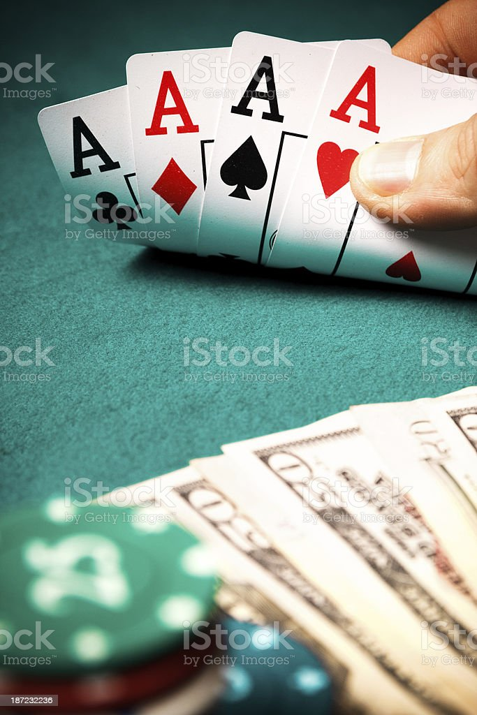Hand of aces and dollar royalty-free stock photo