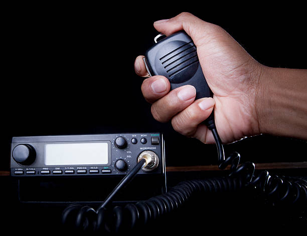 hand of amateur radio holding speaker and press - ham radio stock photos and pictures