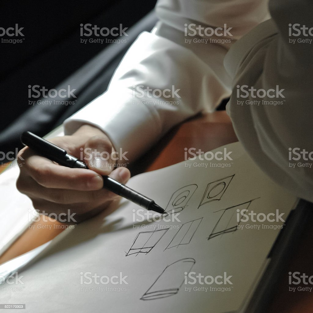 hand of an artist sketch generic conceptual drawings stock photo