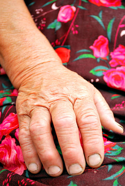 hand of an old peasant stock photo