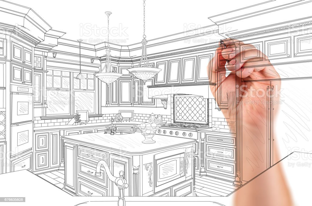 Hand of Architect Drawing Detail of Custom Kitchen Design stock photo