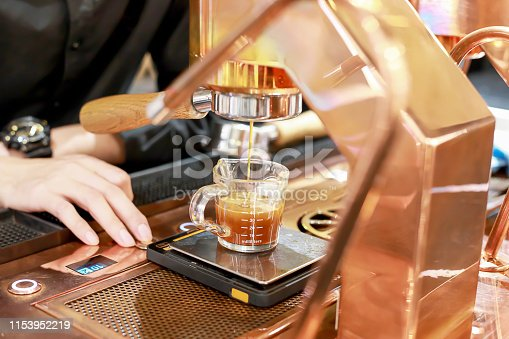 istock Hand of Barista making coffee with the coffee machine in the coffee shop or cafe, Foods and drink concept. Warm Tone. 1153952219