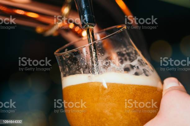 Hand of bartender pouring a lager beer in tap close up picture id1094644332?b=1&k=6&m=1094644332&s=612x612&h=zvutq6gdnkipvuaxx6g6pcrdngx2wd9klectqxklwqs=