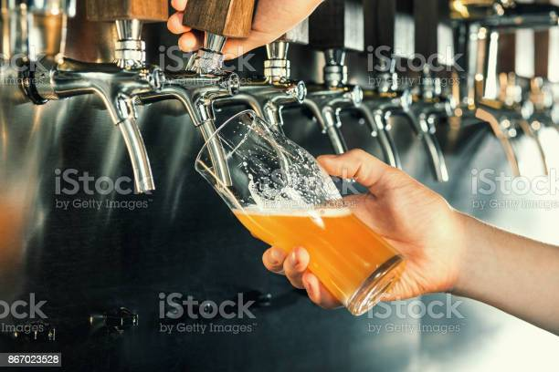 Hand of bartender pouring a large lager beer in tap picture id867023528?b=1&k=6&m=867023528&s=612x612&h=orwbbjbmtr5ynecb6lsvyn o2v9ejqqvpqfsd6wywz8=