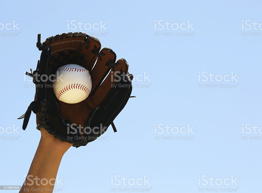 Hand of Baseball Player with Glove and Ball stock photo