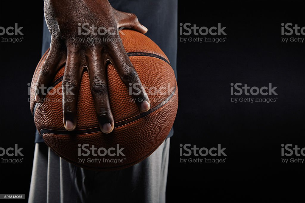 Hand of basketball player holding a ball stok fotoğrafı