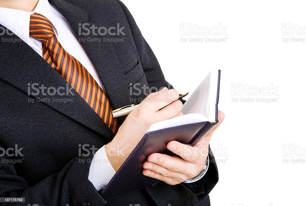 hand of bisnessman writing royalty-free stock photo