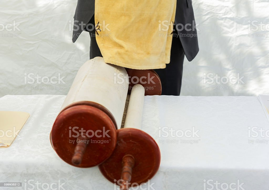 Hand of boy reading the Jewish Torah at Bar Mitzvah stock photo