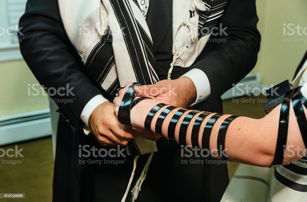 Hand of boy reading the Jewish Torah Bar Mitzvah - Photo