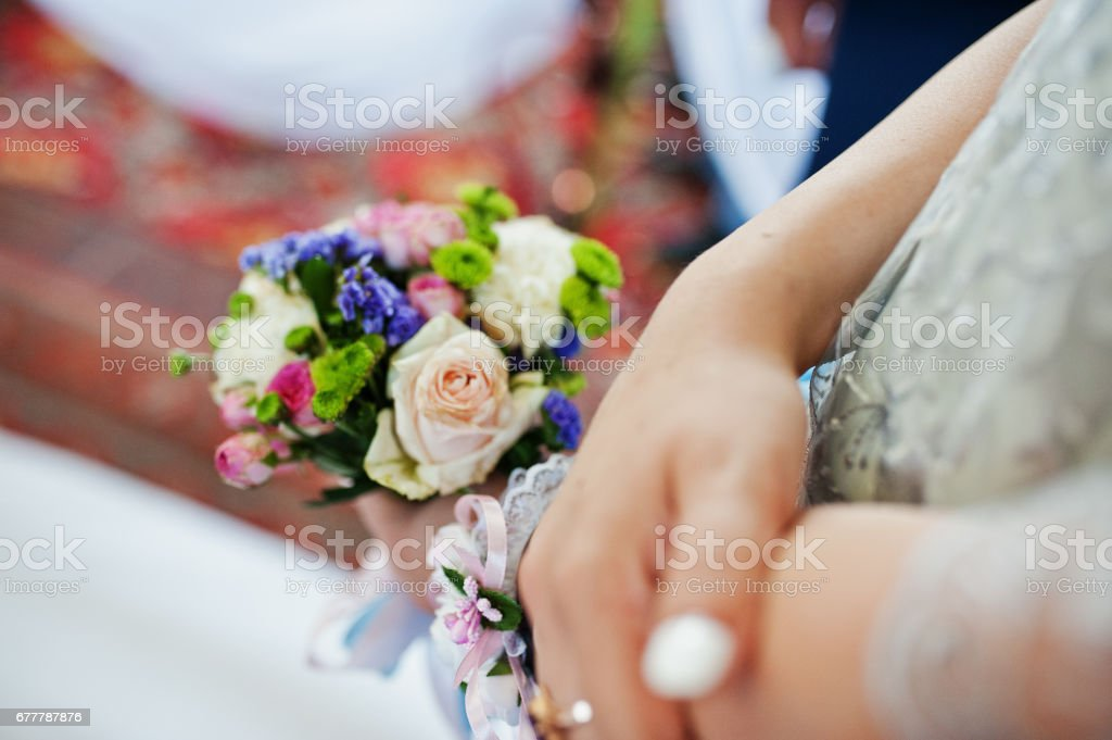 Hand of bridesmaid with wedding bouquet. royalty-free stock photo