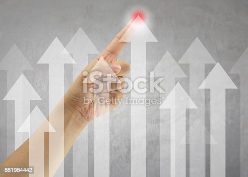 Hand of business man point to the highest point of the arrow in concept of targeted and profitable in presentation.