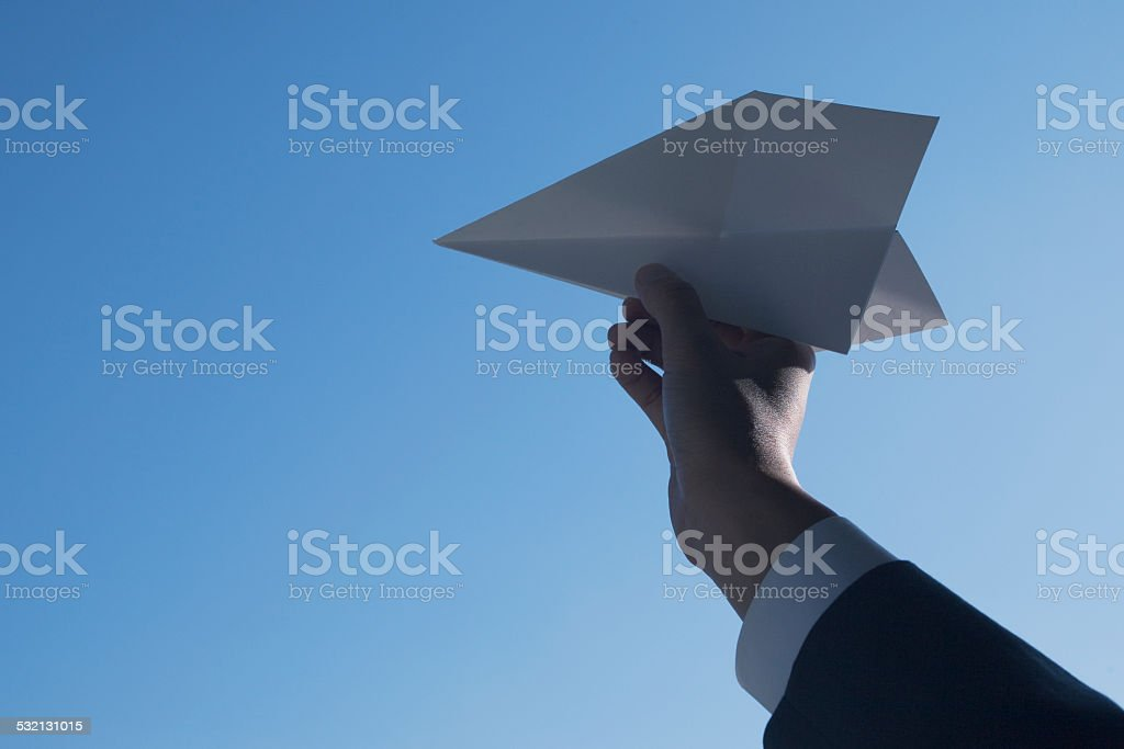 hand of business man with a paper airplane stock photo more