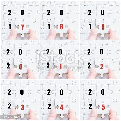 619522908istockphoto Hand of business man with puzzle, years 2017 to 2025 639786142