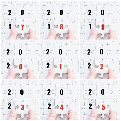 619522908 istock photo Hand of business man with puzzle, years 2017 to 2025 639786142