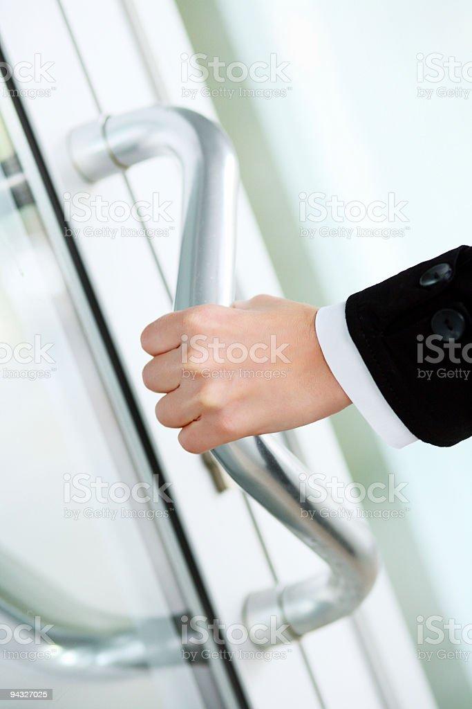 Hand of business woman open door. royalty-free stock photo