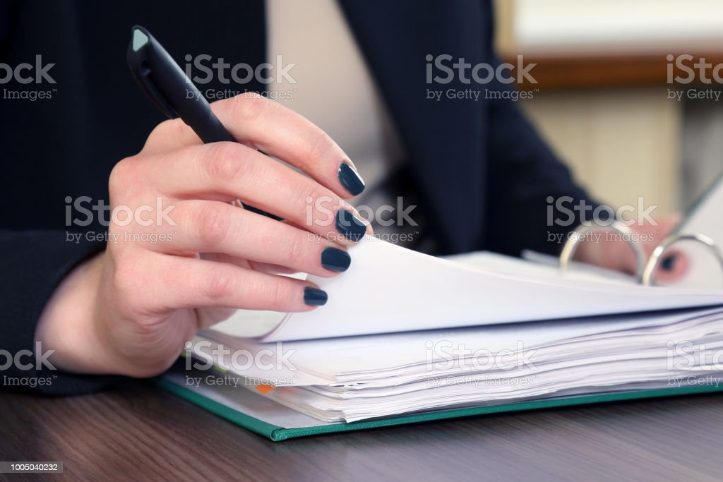 Hand Of Business Woman With Document Viewer Stock Photo
