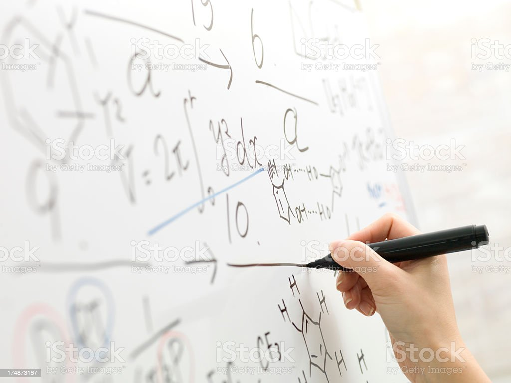 Hand of business woman writing a straight line. royalty-free stock photo