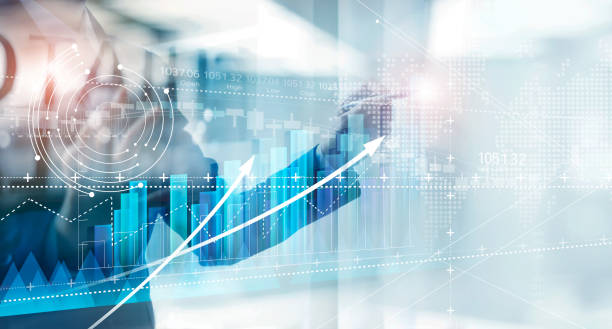 Hand of businessman drawing graphs growth of business, planning and strategy on modern virtual interface screen. stock photo
