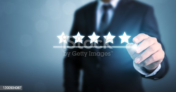 917079212 istock photo Hand of businessman drawing line under five five star symbol to increase rating of company concept 1200934067