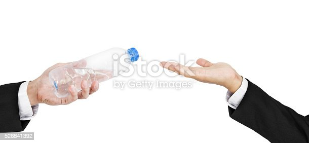 Hand of businessman holding, giving, receiving bottle of water, isolated on white background