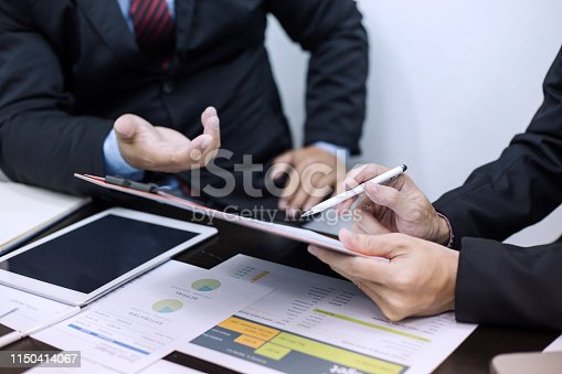 istock Hand of businessman holding the pen point to the graph information during discussion at meeting 1150414067