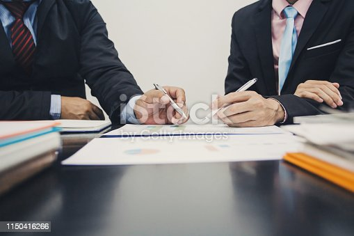 istock Hand of businessman holding the pen point to the graph information during discussion at meeting 1150416266