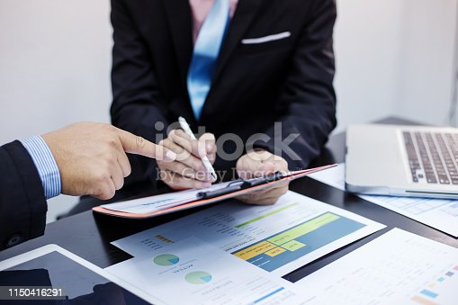 istock Hand of businessman holding the pen point to the graph information during discussion at meeting 1150416291