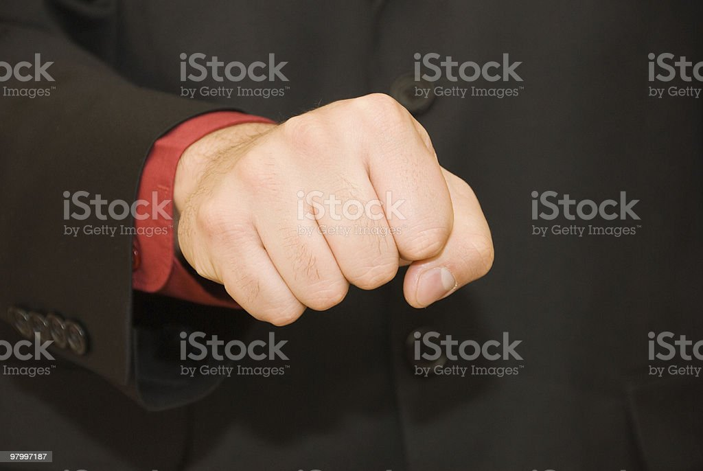 Hand of businessman in a fist royalty-free stock photo