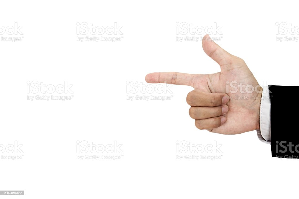 Hand of businessman in suit showing gun sign, isolated stock photo