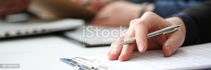 istock Hand of businessman signing document with pen 801300062