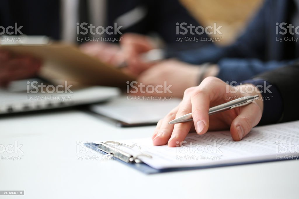 Hand of businessman signing document with pen stock photo