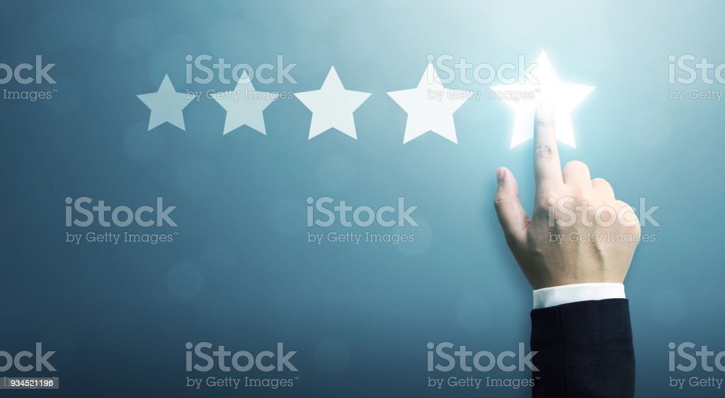 Hand of businessman touching five star symbol to increase rating of company concept, Copy space background for your title stock photo