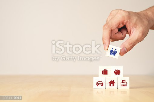 Hand of businessman with concept of coronavirus impact economic and family financial high cost of living and expensive expense spending, real estate loan, household budget, house mortgage, insurance.