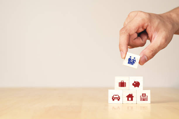 Hand of businessman with concept of coronavirus impact economic and family financial high cost of living and expensive expense spending, real estate loan, household budget, house mortgage, insurance. stock photo