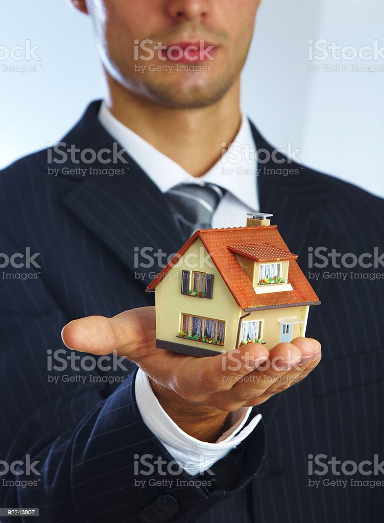 Hand of businessman with the house royalty-free stock photo