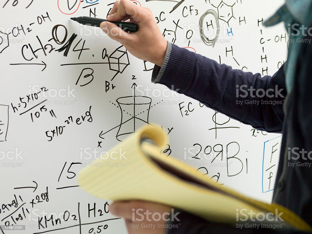 Hand of businessman writing on a whiteboard. royalty-free stock photo