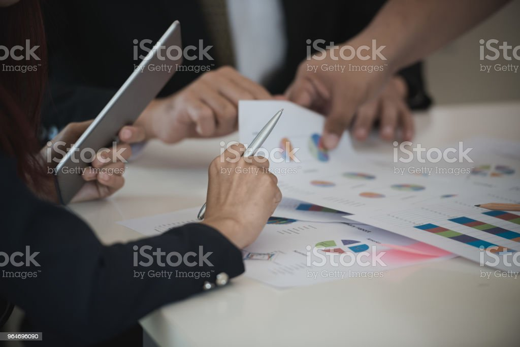 Hand of Businesswoman hold pen and Digital Tablet. analyzing brainstorming, meeting concept. royalty-free stock photo