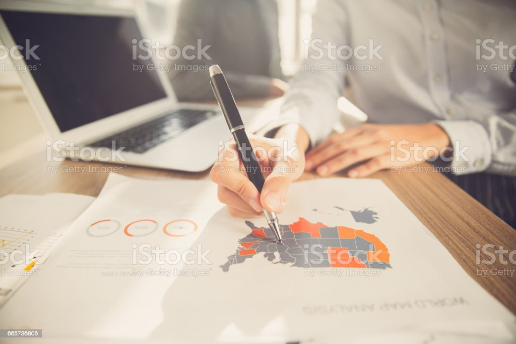 Hand of businesswoman pointing at USA map on paper stock photo