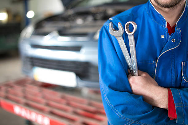 Hand of car mechanic with wrench. Auto repair garage. Hand of car mechanic with wrench. Auto repair garage. mechanic stock pictures, royalty-free photos & images