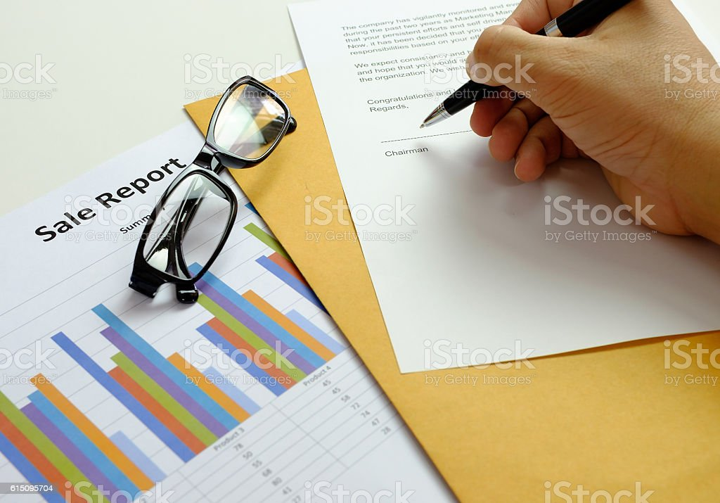 Hand of chairman hold pen signing a congratulations in letter stock photo