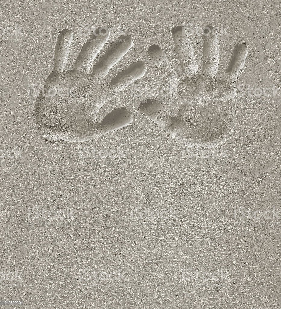 Hand of child prints on cement royalty-free stock photo