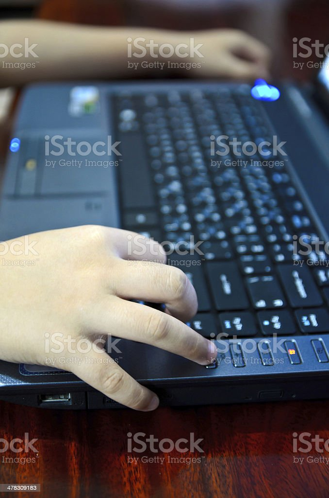 hand of child typing computer royalty-free stock photo